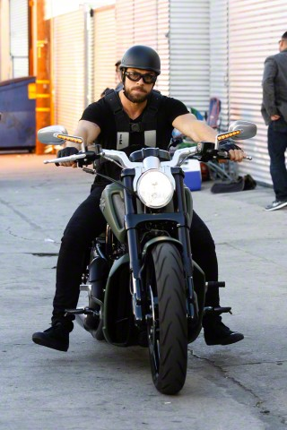 Artem Chigvintsev rides his motorcycle to the studio